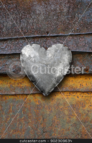 Metal heart on rusty background stock photo, Photo of metal heart on a rusting iron background. by © Ron Sumners