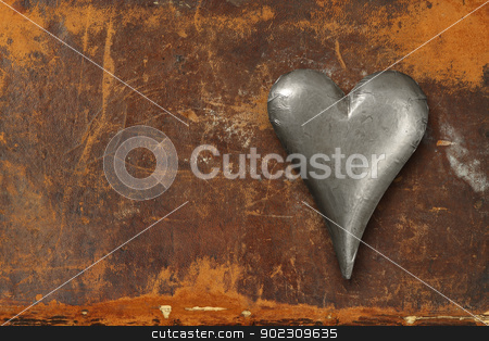 Metal heart on grunge background stock photo, Photo of a metal heart sitting on an old leather book cover.  by © Ron Sumners