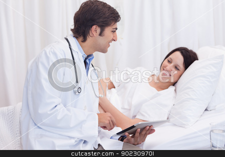Doctor telling his patient the good news stock photo, Young doctor telling his patient the good news by Wavebreak Media
