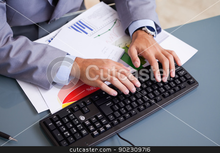 Hands typing on keyboard stock photo, Male hands typing on keyboard by Wavebreak Media