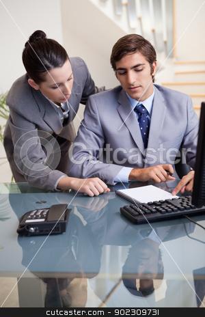 Businesswoman mentoring her new colleague stock photo, Young businesswoman mentoring her new colleague by Wavebreak Media