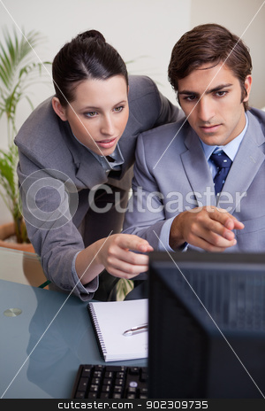 Businesswoman helping her new colleague stock photo, Young businesswoman helping her new colleague by Wavebreak Media