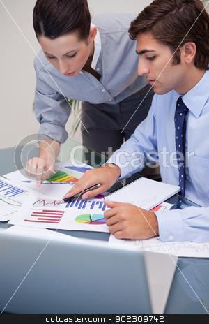 Business team working on sales statistic stock photo, Young business team working on sales statistic by Wavebreak Media