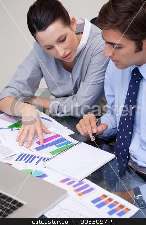 Business team analyzing charts stock photo, Young business team analyzing charts by Wavebreak Media