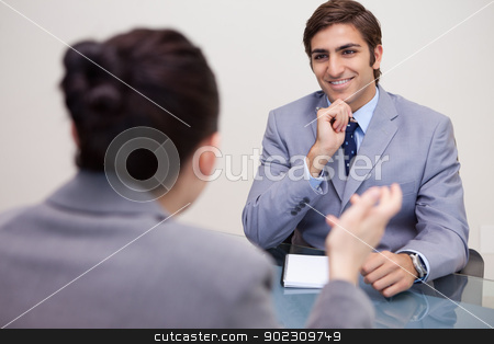 Smiling businessman in a negotiation stock photo, Smiling young businessman in a negotiation by Wavebreak Media