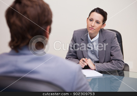 Businesswoman listening to her business partner stock photo, Young businesswoman listening to her business partner by Wavebreak Media