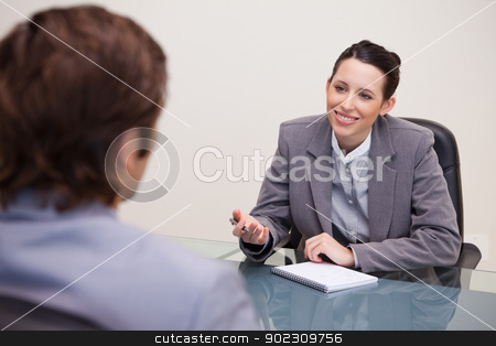Smiling businesswoman in a negotiation stock photo, Smiling young businesswoman in a negotiation by Wavebreak Media