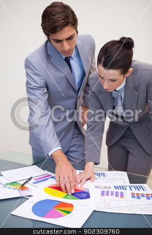 Consultant and customer looking at statistics stock photo, Young consultant and customer looking at statistics by Wavebreak Media