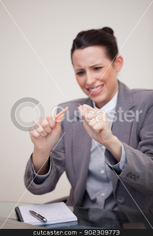 Angry businesswoman broke her pencil stock photo, Angry young businesswoman broke her pencil by Wavebreak Media