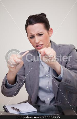 Businesswoman just broke her pencil stock photo, Young businesswoman just broke her pencil by Wavebreak Media