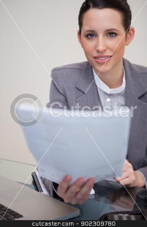 Businesswoman handing over paperwork stock photo, Young businesswoman handing over paperwork by Wavebreak Media