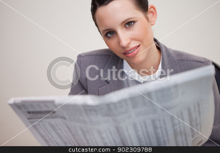 Businesswoman with newspaper stock photo, Young businesswoman with newspaper by Wavebreak Media