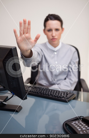 Businesswoman signals stop stock photo, Young businesswoman signals stop by Wavebreak Media