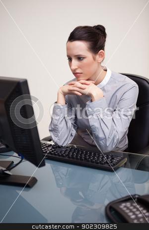 Businesswoman staring at her computer screen stock photo, Young businesswoman staring at her computer screen by Wavebreak Media