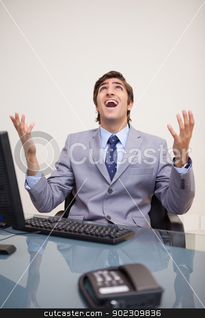 Businessman screaming out loud stock photo, Young businessman screaming out loud by Wavebreak Media