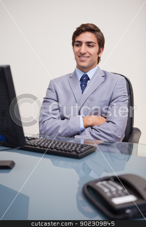 Businessman leaning back satisfied stock photo, Young businessman leaning back satisfied by Wavebreak Media