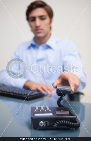 Phone being hung up by businessman stock photo, Phone being hung up by young businessman by Wavebreak Media