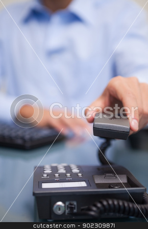 Telephone being hung up by businessman stock photo, Telephone being hung up by young businessman by Wavebreak Media
