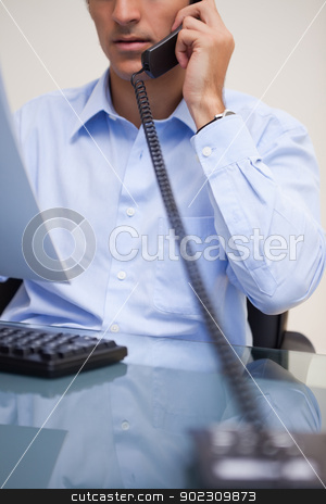 Businessman on the telephone stock photo, Young businessman on the telephone by Wavebreak Media
