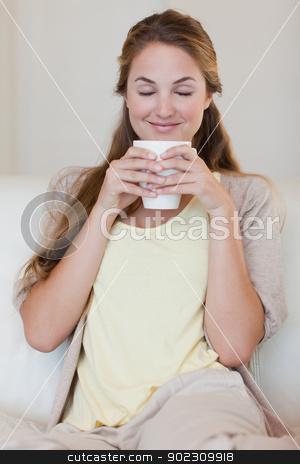Woman enjoys smelling on her fresh made coffee stock photo, Young woman enjoys smelling on her fresh made coffee by Wavebreak Media