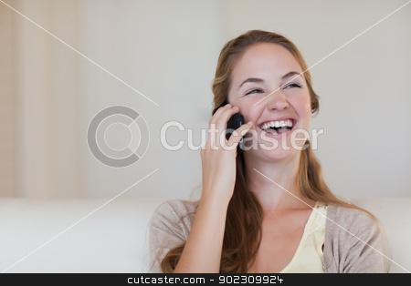 Woman enjoying call on her cellphone stock photo, Young woman enjoying call on her cellphone by Wavebreak Media