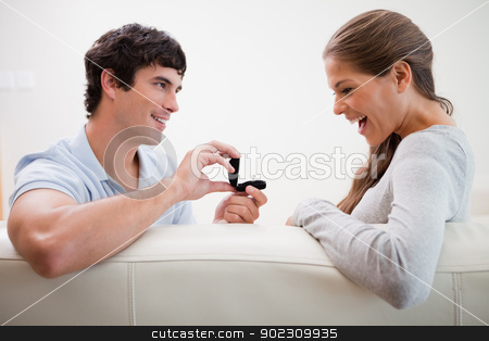 Man making a proposal to his girlfriend stock photo, Young man making a proposal to his girlfriend by Wavebreak Media