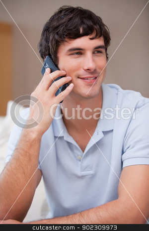 Man answering phonecall stock photo, Young man answering phonecall by Wavebreak Media