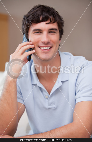 Smiling man on the cellphone stock photo, Smiling young man on the cellphone by Wavebreak Media