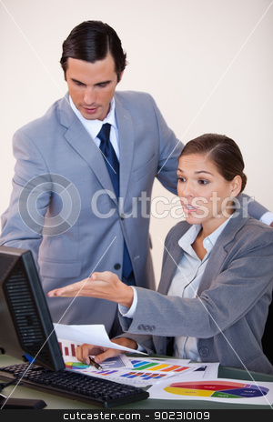 Business people analyzing statistics together stock photo, Young business people analyzing statistics together by Wavebreak Media