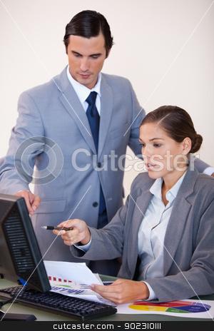 Businessman talking with secretary stock photo, Young businessman talking with secretary by Wavebreak Media