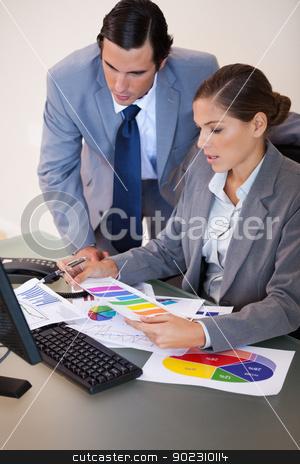 Businesswoman explaining statistics to her colleague stock photo, Young businesswoman explaining statistics to her colleague by Wavebreak Media