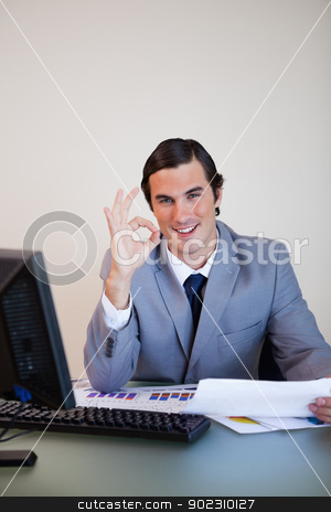 Businessman approving paperwork stock photo, Smiling businessman approving paperwork by Wavebreak Media