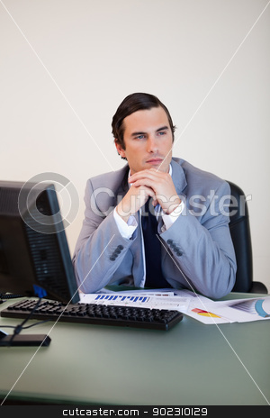 Businessman in thoughts stock photo, Businessman with hands folded in thoughts by Wavebreak Media