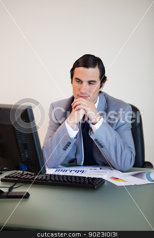 Businessman waiting for his pc stock photo, Businessman waiting for his pc to boot up by Wavebreak Media