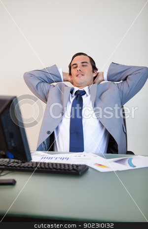 Businessman leaning back stock photo, Businessman leaning back in his chair by Wavebreak Media