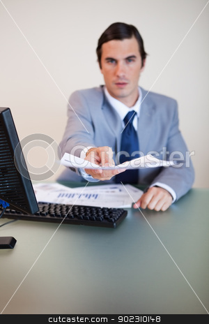 Contract being handed over by businessman stock photo, Contract being handed over by businessman at his desk by Wavebreak Media