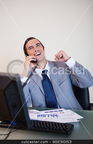 Cheerful businessman on the phone stock photo, Cheerful businessman on the phone raising hand by Wavebreak Media