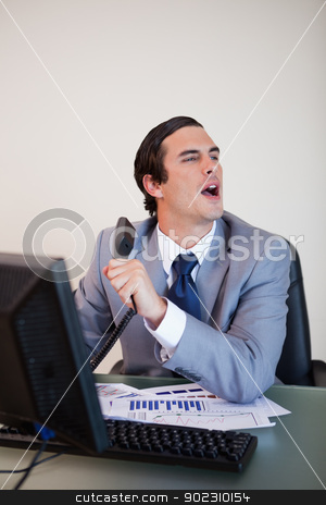 Businessman asking for information his caller needs stock photo, Businessman asking colleague for information his caller needs by Wavebreak Media