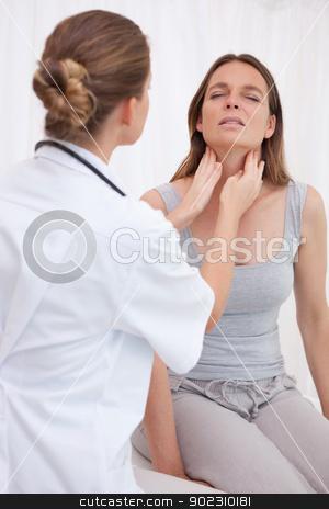 Doctor examining patients throat stock photo, Doctor examining patients painful throat by Wavebreak Media