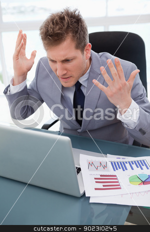 Businessman getting furious over laptop stock photo, Businessman getting furious over not working laptop by Wavebreak Media