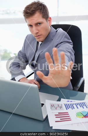 Businessman signals stop stock photo, Businessman at his desk signals stop by Wavebreak Media