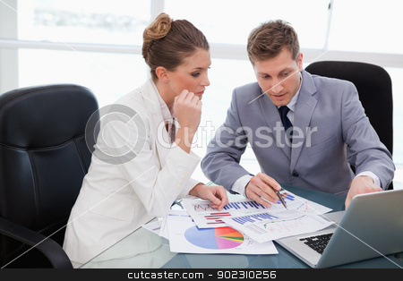 Business team analyzing market research stock photo, Business team analyzing market research data by Wavebreak Media