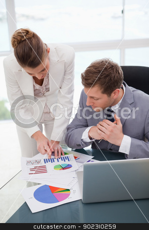 Businesswoman explaining research results stock photo, Businesswoman explaining research results to colleague by Wavebreak Media