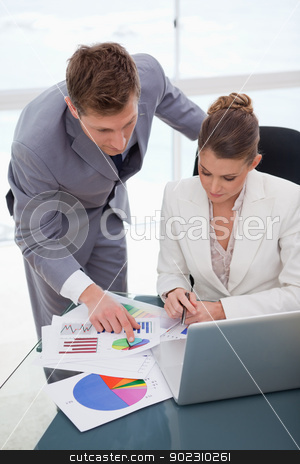 Business team  analyzing survey results stock photo, Business team analyzing survey results together by Wavebreak Media
