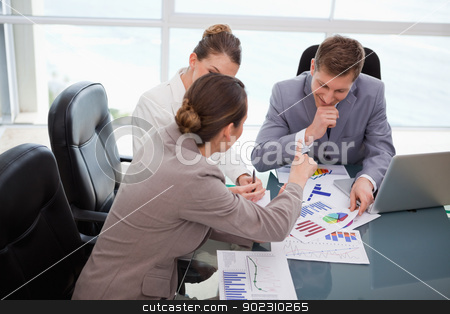 Business team discussing over market research stock photo, Business team discussing over market research results by Wavebreak Media
