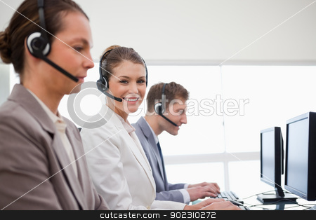 Side view of telephone service office employees stock photo, Side view of telephone service office employees at work by Wavebreak Media