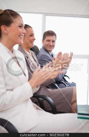 Side view of business team applauding stock photo, Side view of business team applauding after a presentation by Wavebreak Media