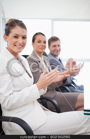 Side view of employees applauding stock photo, Side view of employees applauding after presentation by Wavebreak Media