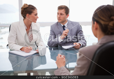 Business team deliberating with lawyer stock photo, Business team deliberating with their lawyer by Wavebreak Media
