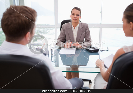 Lawyer advising her clients stock photo, Lawyer advising her clients in her office by Wavebreak Media
